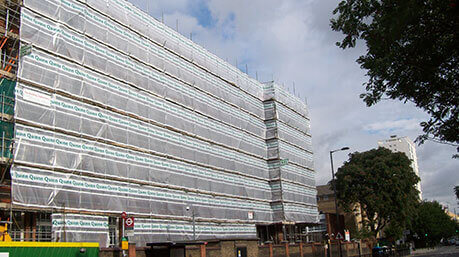 Covered scaffolding on commercial building