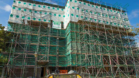 Scaffolding with safety barriers